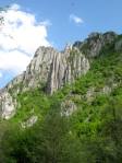 The steep limestone hills that loom over the gorge.