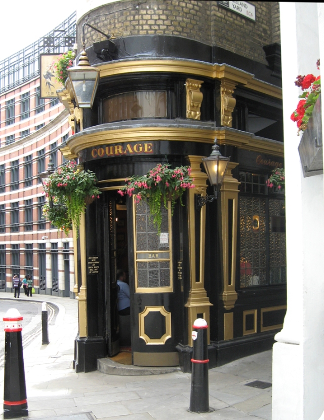 Not actually the name of the pub; possibly just a general remark on life. The world needs more buildings painted black and gold, too. I like it.