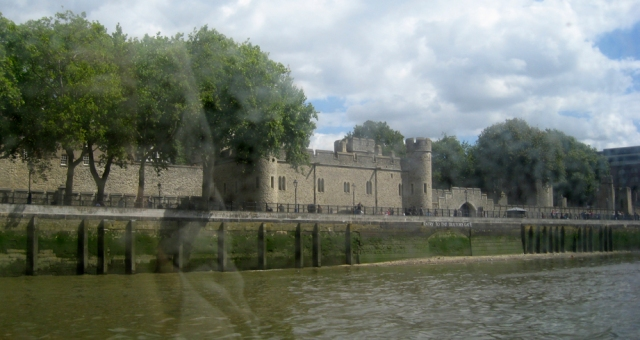 View of the Tower through a window, blurrily, heading upriver.