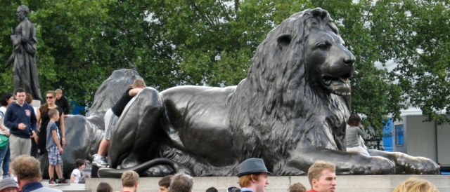 Another Trafalgar Lion, amid a sea of tourists. Amazingly, there is some greenery about him.