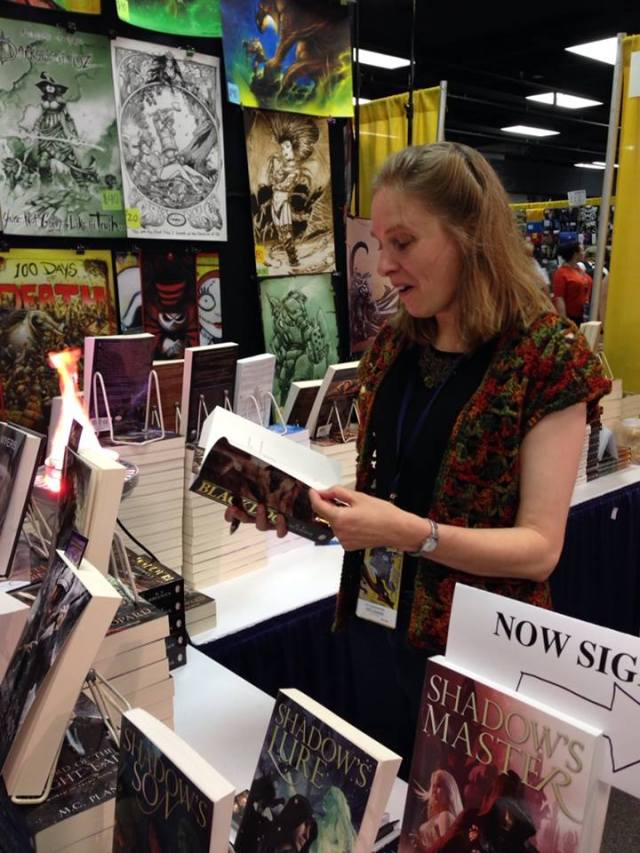 Signing books at the Pyr Booth at DragonCon 2014. All photos in this post are by Lou Anders - the silly expression is his fault.